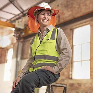 Girl on stool in PPE