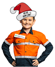 Young boy wearing a santa hat