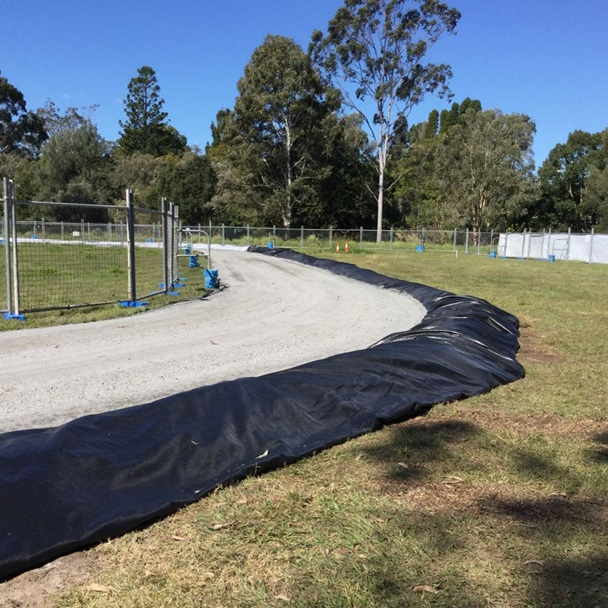 Temporary access road to construction area around outside of rugby field